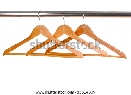wooden clothes hangers isolated on white - stock photo