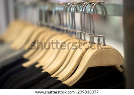 Wooden clothes hangers with blur and vignette background - stock photo