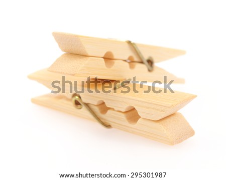 Wooden clothespins isolated on white background - stock photo