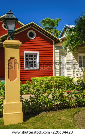 Wooden colored houses typical for Caribbean Islands - stock photo