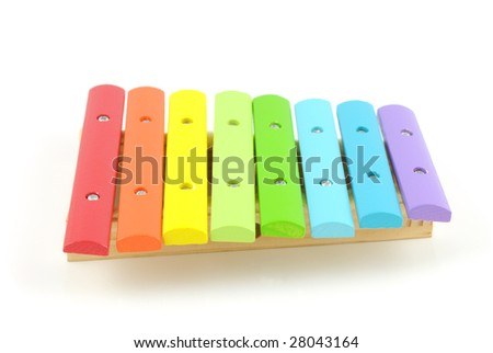 Wooden colored xylophone isolated on white background - stock photo