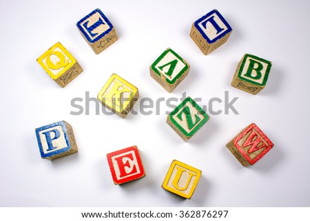 Wooden Colorful Letters on White Background. - stock photo