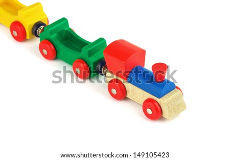 Wooden colorful toy train isolated on white background - stock photo