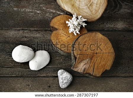 wooden composition with different textures and white stones - stock photo