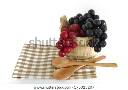 Wooden cooking utensils with bucket on white - stock photo