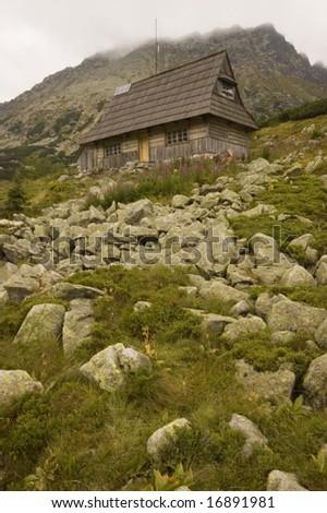 Wooden cottage in Polish Tatra mountains - stock photo