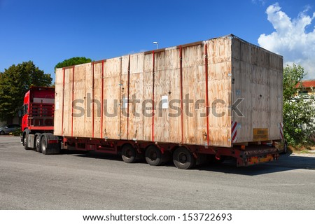 wooden crate on oversize load  truck shipment - stock photo