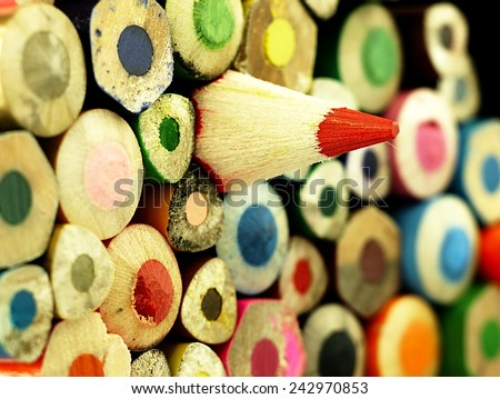 Wooden crayons. Different than other.  Multicolored surface.    - stock photo