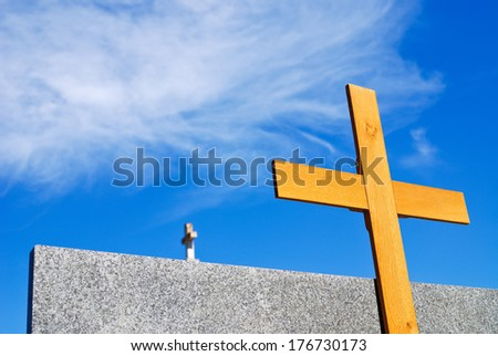 Wooden cross at the cementary - stock photo