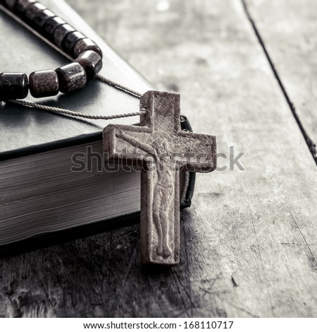 wooden cross on a wooden surface closeup - stock photo