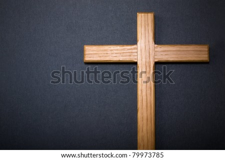 Wooden cross on dark background - stock photo