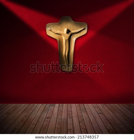Wooden Crucifix in Red Room - Religious Background / Light brown wooden crucifix hanging on red velvet wall and two top lights - Christian religion background - stock photo
