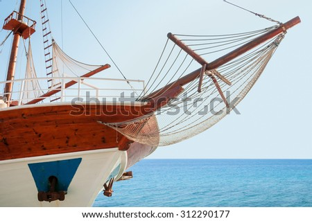Wooden cruising yacht's bow - stock photo