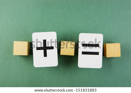 wooden cube and school card with math problems - stock photo