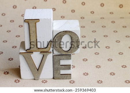 Wooden cubes forming the word LOVE - stock photo