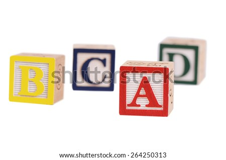 Wooden cubes with letters isolated on white - stock photo