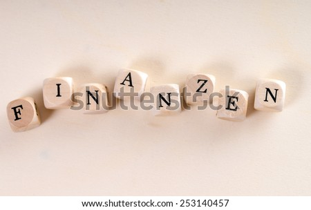 wooden cubes with the german word finance / Finance - stock photo