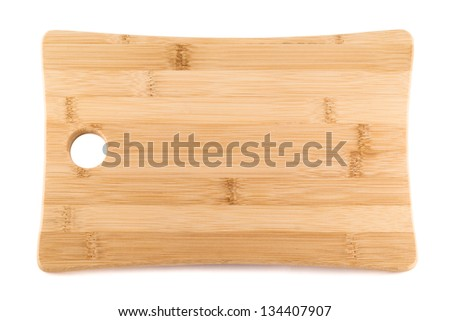 Wooden cutting board isolated over white background - stock photo