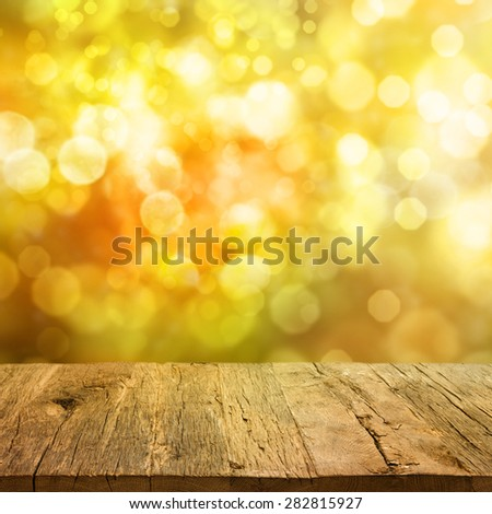 Wooden deck table over beautiful autumn background - stock photo