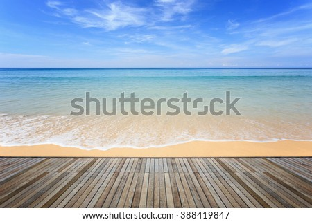 Wooden decking and view of tropical beach background - stock photo