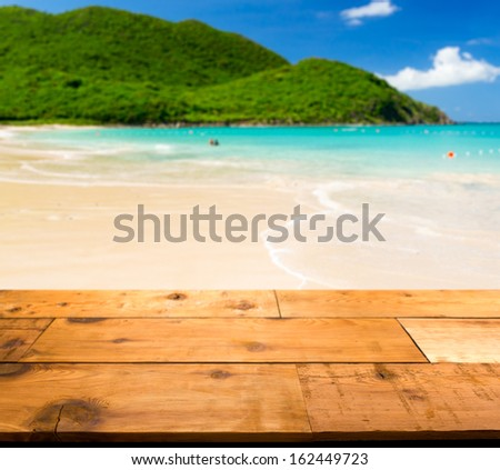 Wooden decking or picnic table on Anse Marcel beach on St Martin in Caribbean in idyllic dreamlike location - stock photo