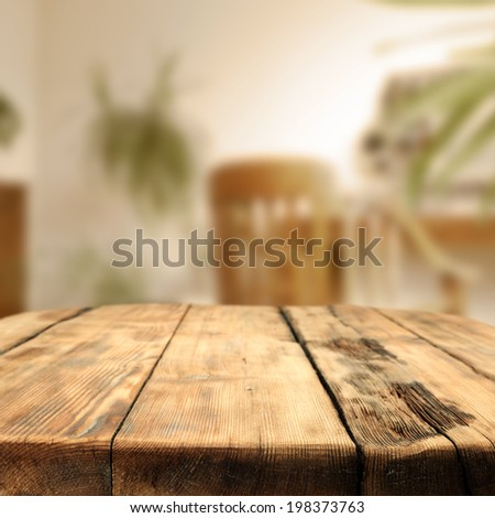 wooden desk in room and sunlight  - stock photo