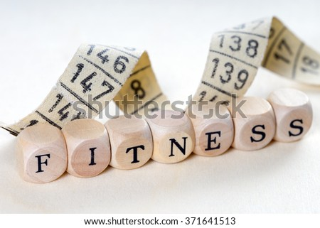 Wooden dice with the word Fitness / Fitness - stock photo