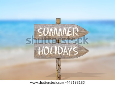 Wooden direction sign with summer holidays - stock photo