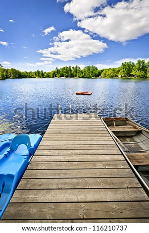 Wooden dock on beautiful summer lake in Ontario Canada - stock photo