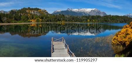Wooden dock on mountain lake, Patagonia, Argentina - stock photo