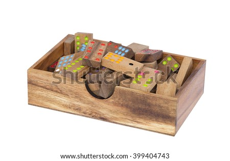 Wooden dominoes in a wooden box isolated - stock photo