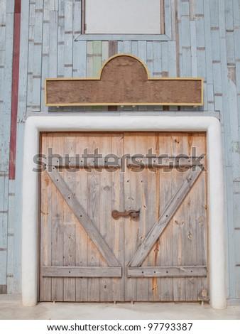 Wooden door and banner - stock photo