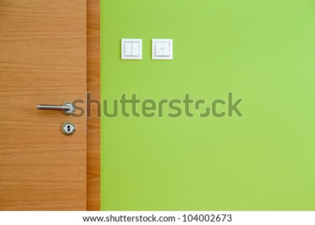 Wooden Door and Green Wall Copy Space - stock photo
