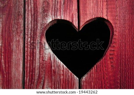 Wooden door close-up, heart shape - stock photo