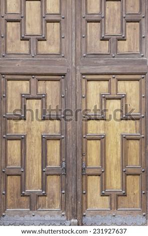 Wooden door entrance to church cross, symbol - stock photo