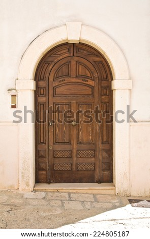 Wooden door. Fasano. Puglia. Italy. - stock photo