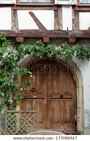 Wooden door in Eguisheim village along the famous wine route in Alsace, France - stock photo