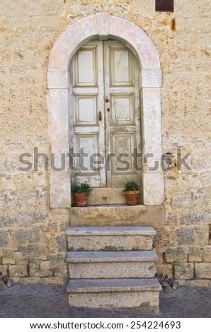 Wooden door. Pietragalla. Basilicata. Italy. - stock photo