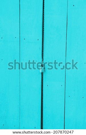 Wooden door with a key lock. - stock photo