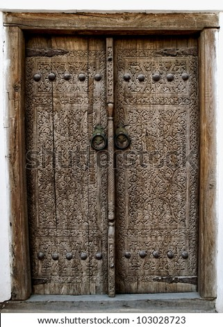 Wooden door with ancient floral patten. Wood carving technic. - stock photo