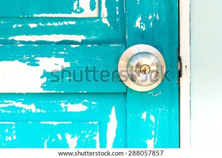 wooden door with door knob - stock photo
