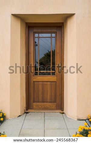 Wooden door with glass - stock photo