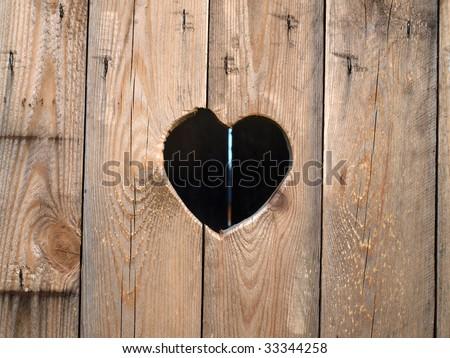 Wooden door with heart - stock photo