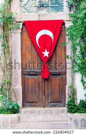 Wooden door with Turkish flag  - stock photo