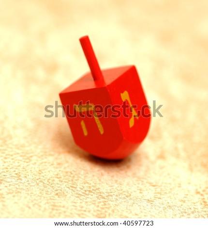 Wooden dreidel - symbol of hanukkah - stock photo