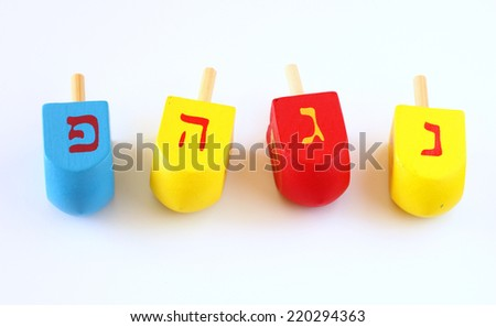 wooden dreidels (spinning top) for hanukkah jewish holiday  - stock photo