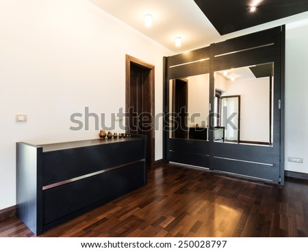 wooden dresser and wardrobe with mirrors - stock photo