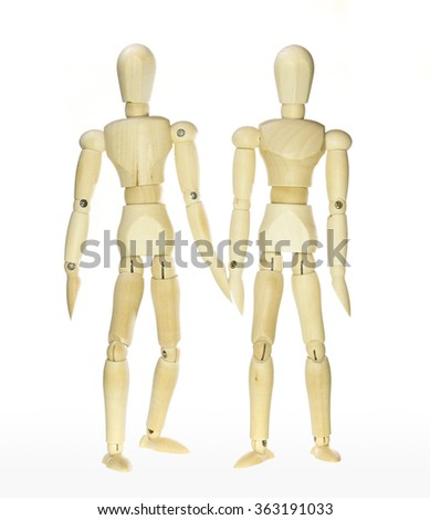 Wooden dummies -friendship (isolated on white background) - stock photo
