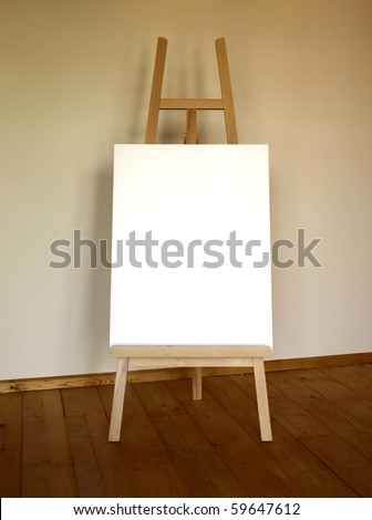 Wooden easel with blank canvas - stock photo