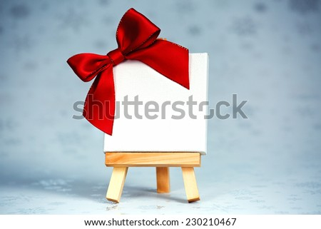 wooden easel with blank canvas on christmas background  - stock photo